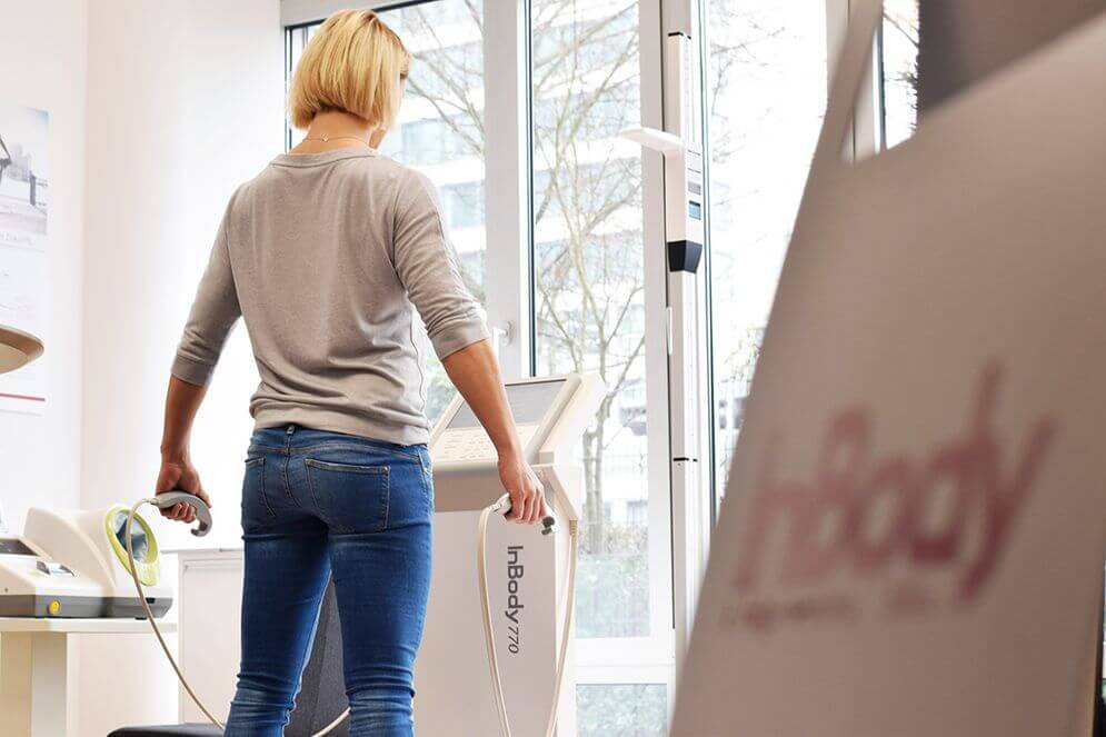 A woman testing on the InBody 770 body composition analyzer