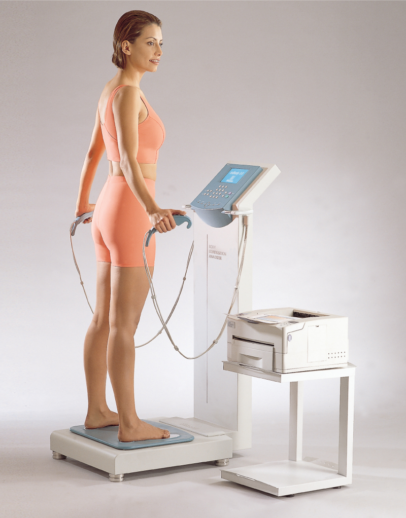 a woman using the InBody body composition analyzer